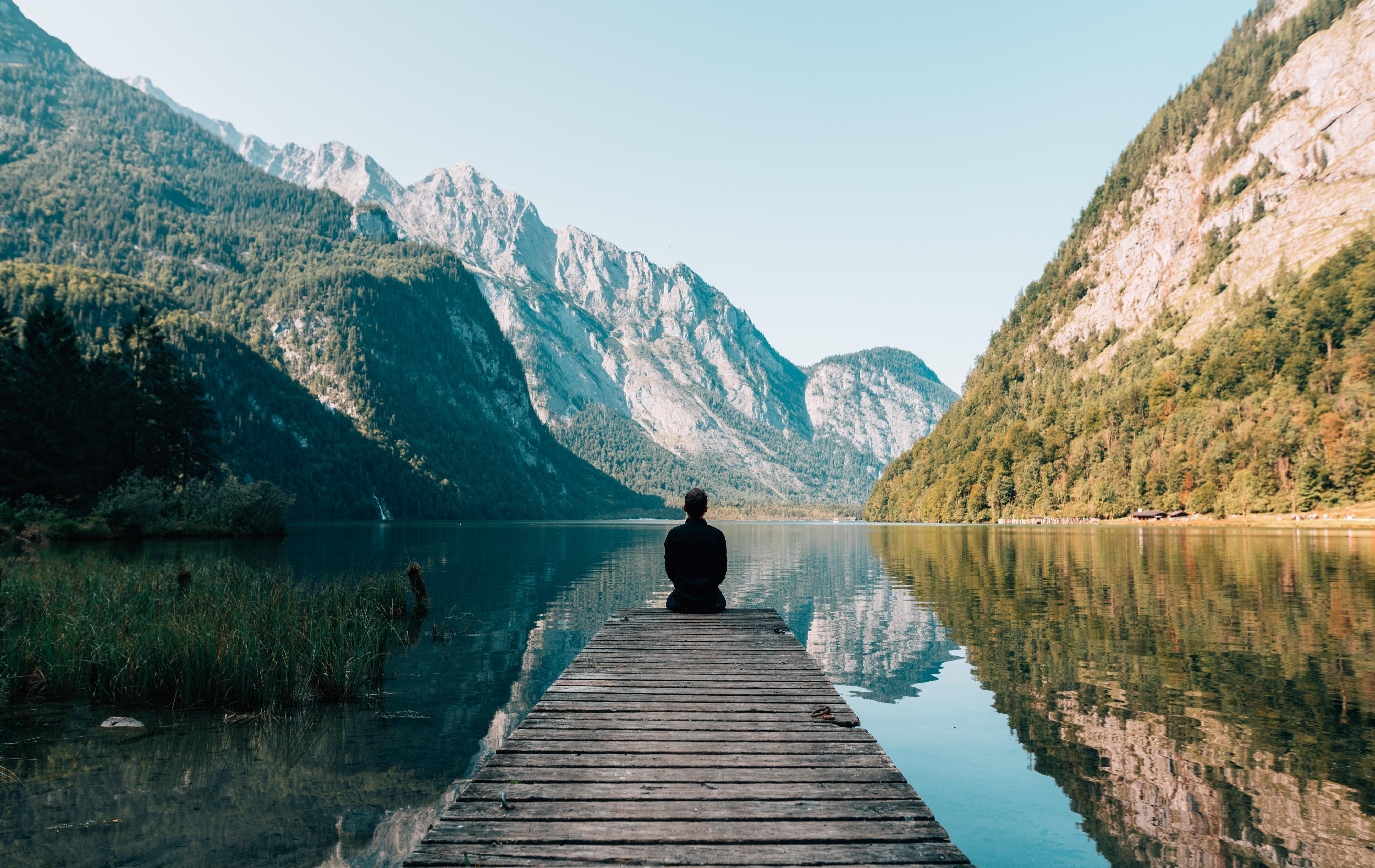 man-sitting-on-dock